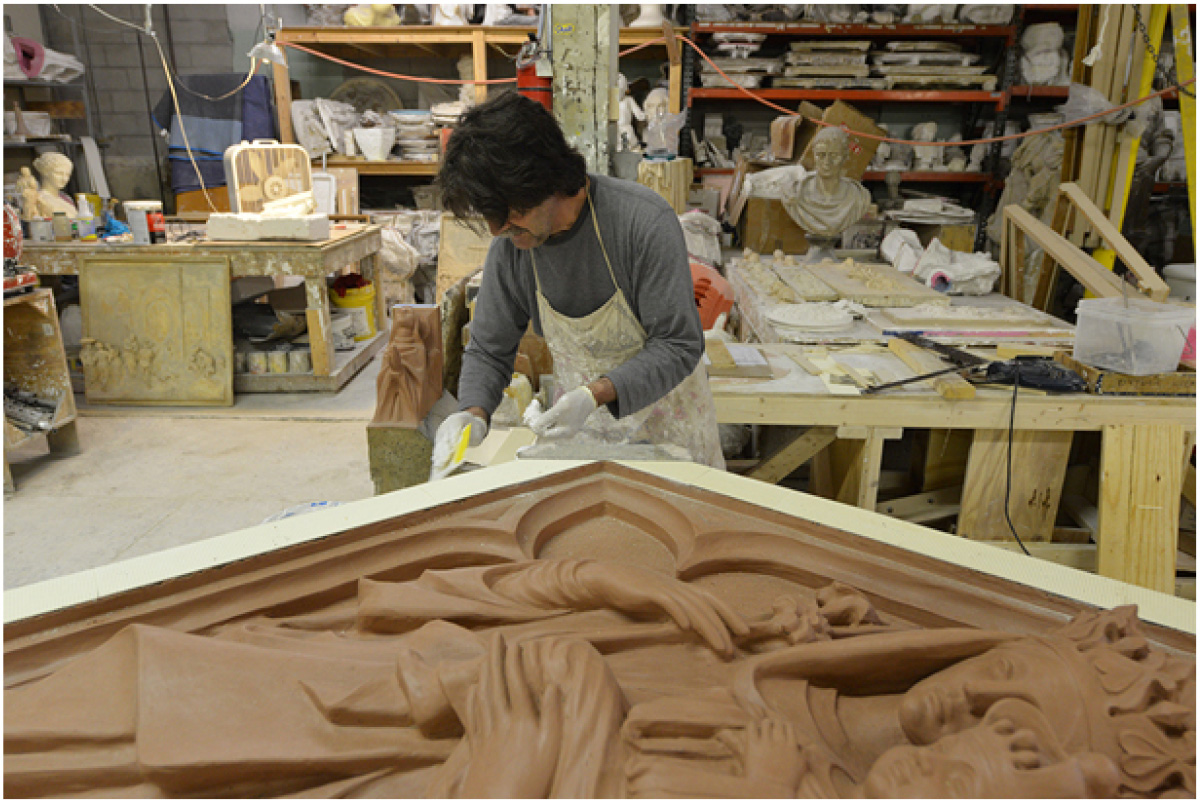 Artist using oil-based clay to rebuild historic details